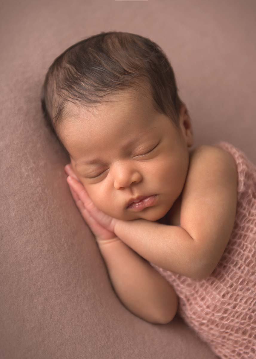Ethnic newborn baby sleeping peacefully in this photo taken in Westchester Co, NY.