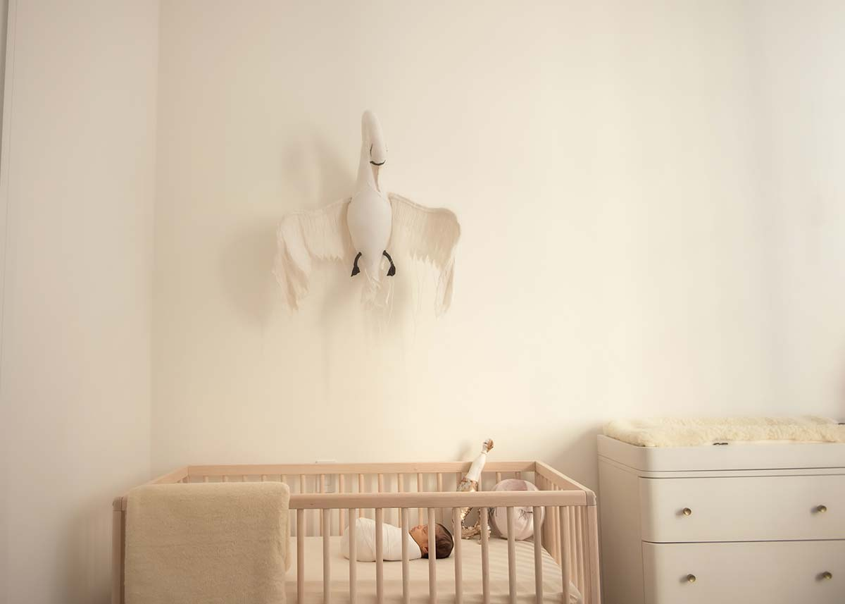 Photo of a beautifully decorated nursery with a baby sleeping in the crib at this modern apartment in Scarsdale, NY.