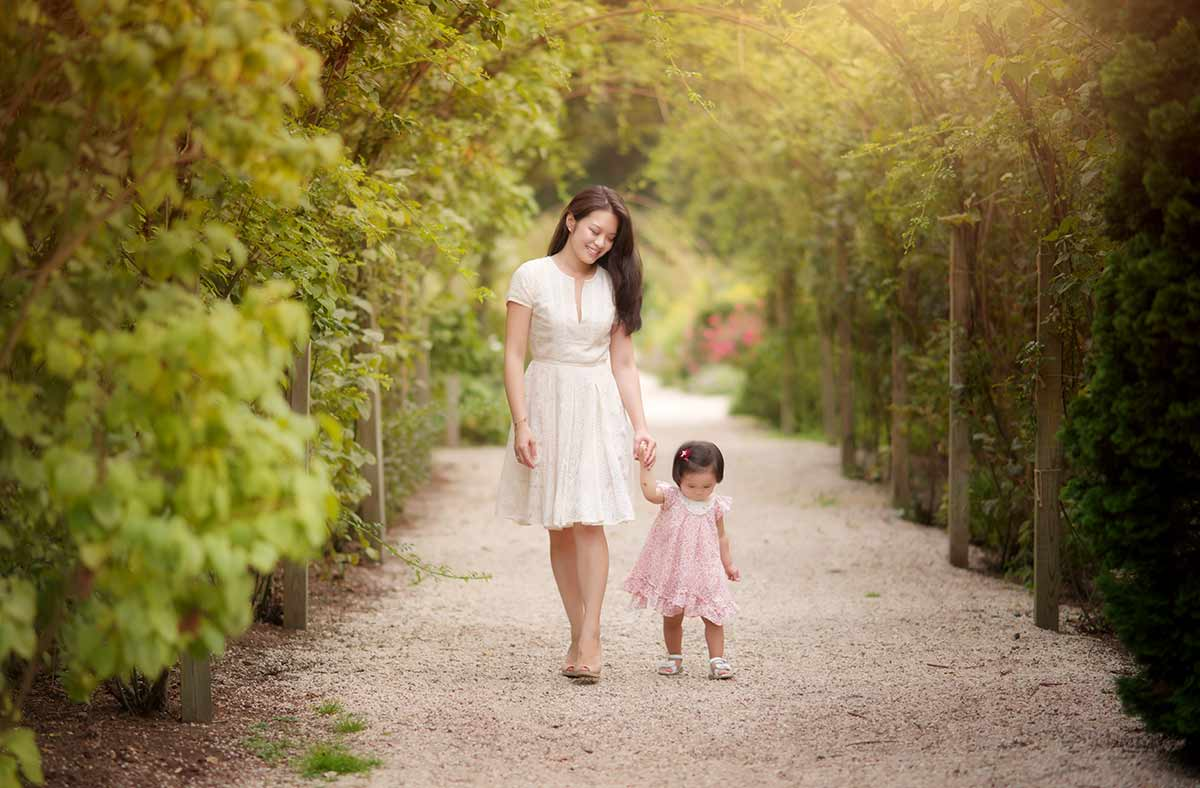 Mother and her baby walking through a bridle path in a park in Westchester county New York
