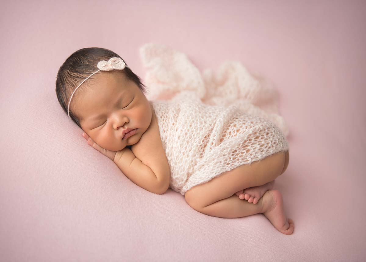 Stunning photo of a newborn in a knit wrap