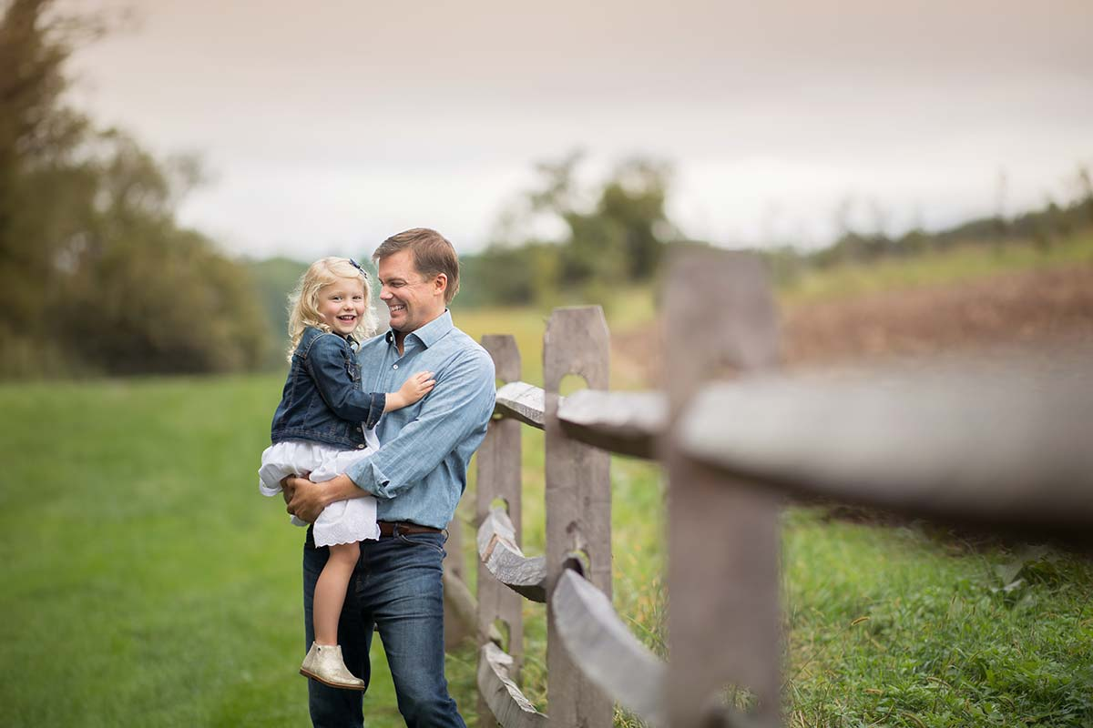 A farm in Danbury CT is the setting for this beautiful family photograph between a father and his young daughter.