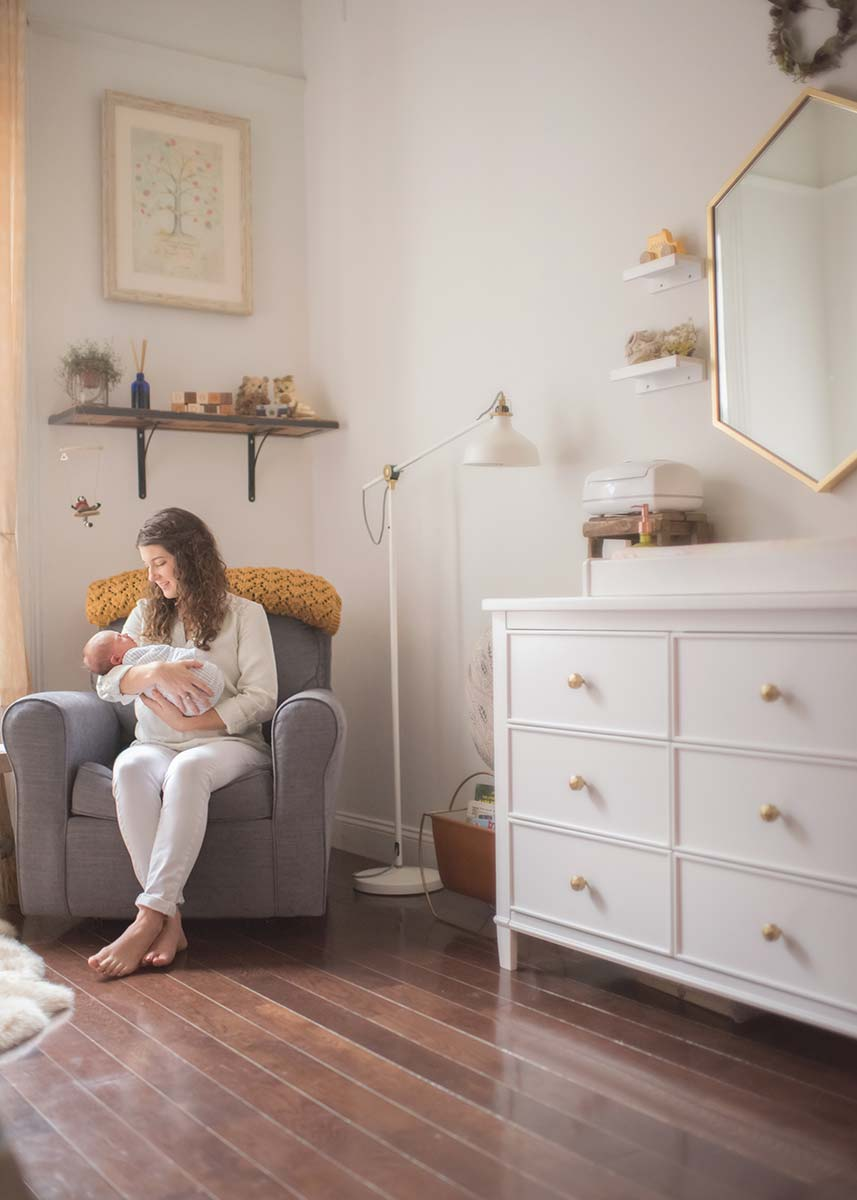 Connecticut Farmhouse remodeled into a beautiful nursery is the setting for this timeless newborn photo between a mother and her infant baby.