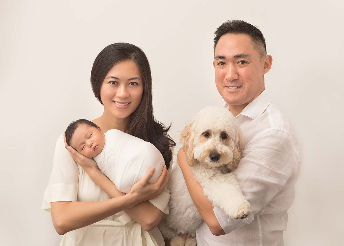 This Greenwich CT family posing for their first photo with their newborn baby
