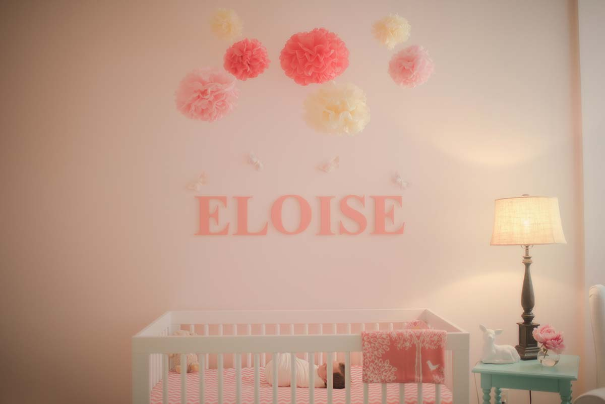 Modern nursery complete with a crib, and baby's name in this contemporary apartment in Stamford CT.