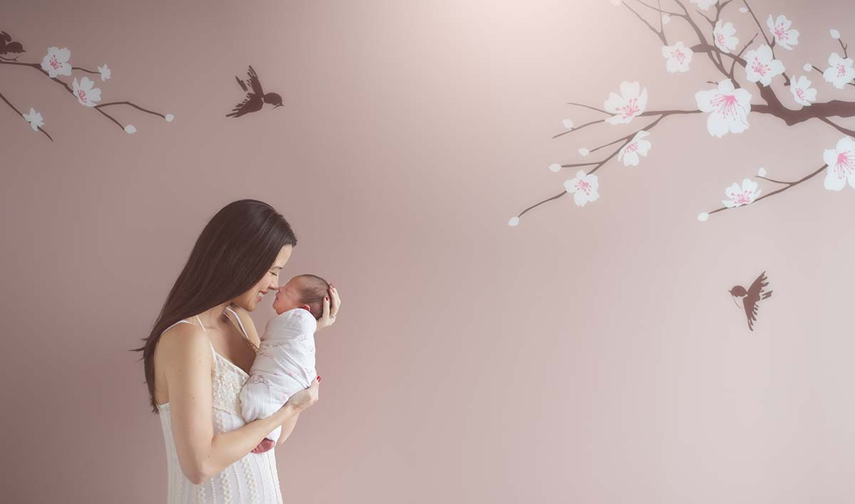 Modern baby nursery from Scarsdale NY with a Mother and her baby as captured by a newborn photographer