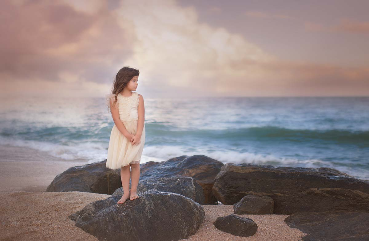 Rocks on a beach near Greenwich, CT are the setting for this beautiful sea photo of a girl in a tutu posing for a portrait