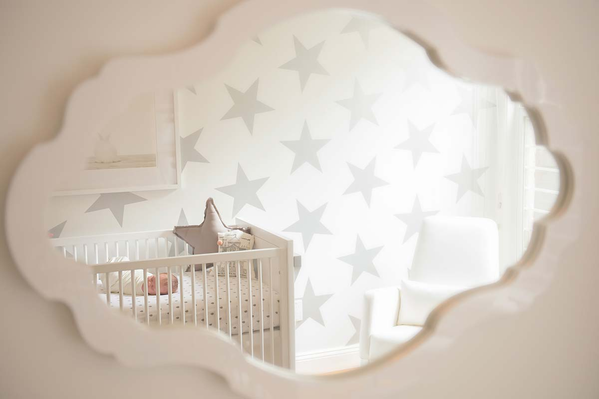 Modern day nursery with contemporary furniture and a sleeping baby