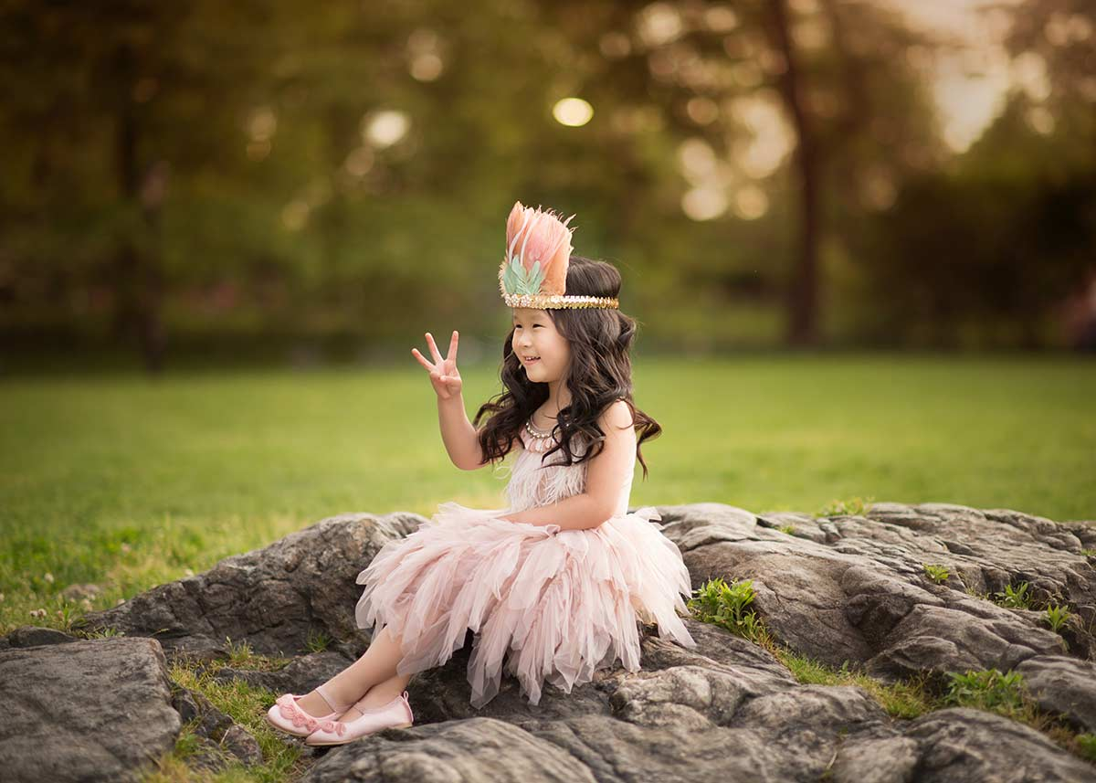 Girl in Tutu Du Monde and a headband playing in a park near Bronxville NY