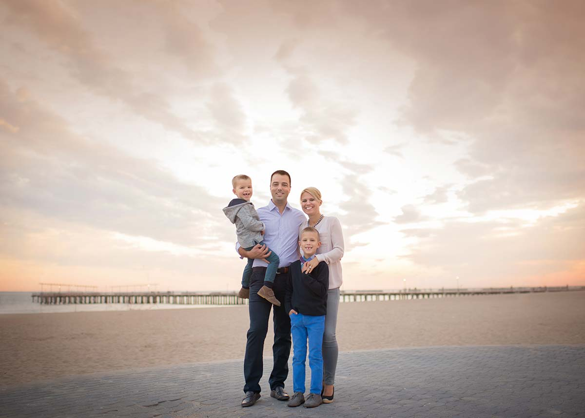 Beautiful family on the beach posing for a photo in Stamford CT