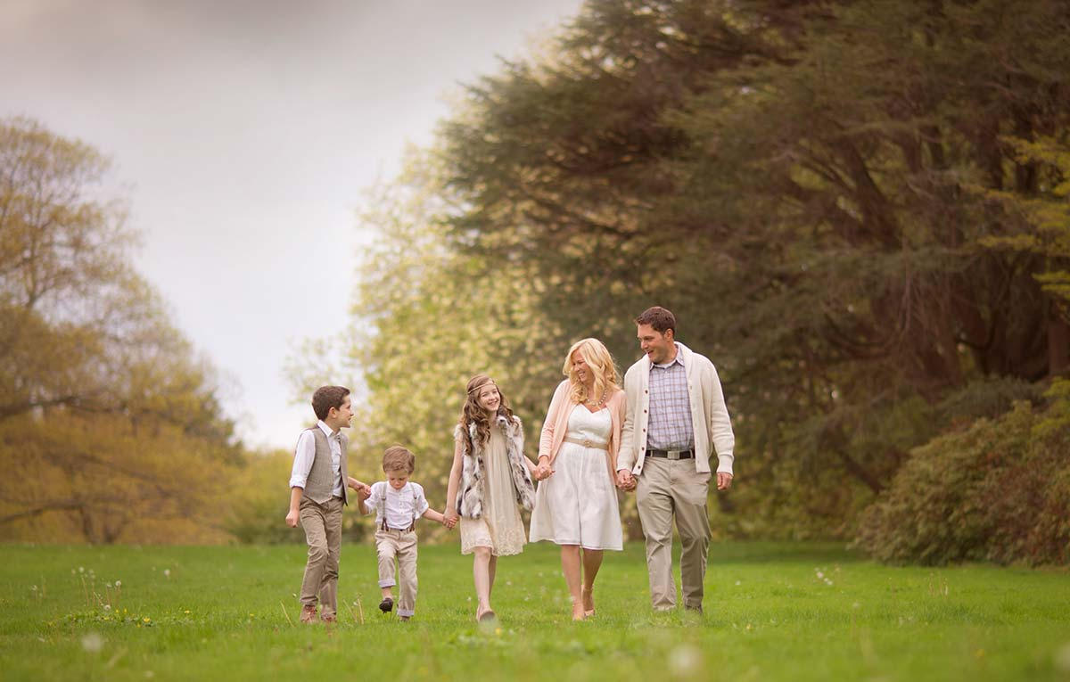 Happy family walking in a park during their photoshoot in Westchester
