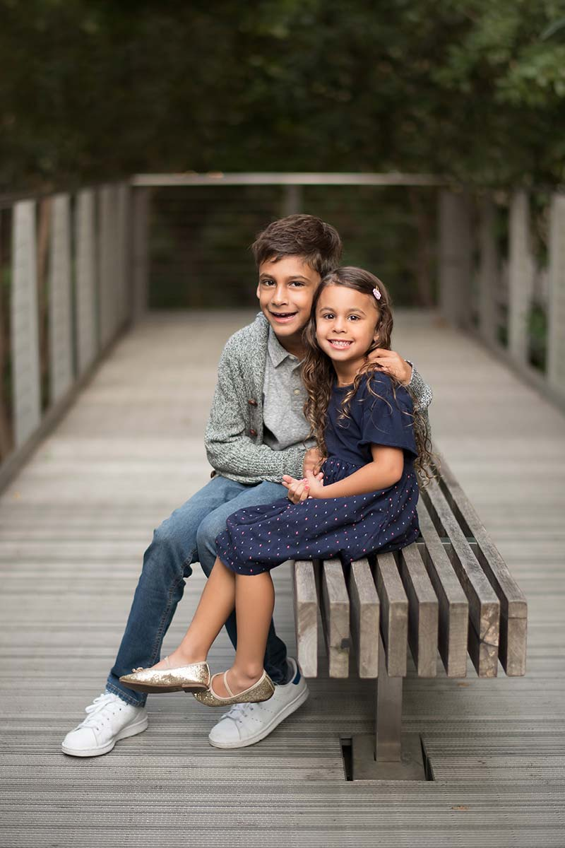 Modern park in Greenwich CT is the setting for this beautiful sibling portrait of a boy and a girl.